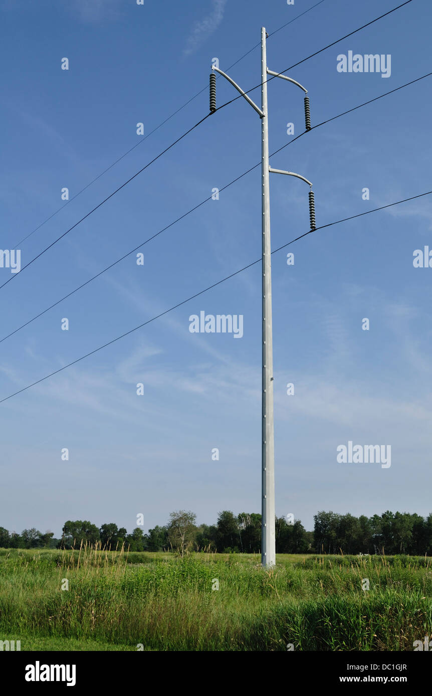 Power Lines Against a Clear Blue Sky - Stock Image