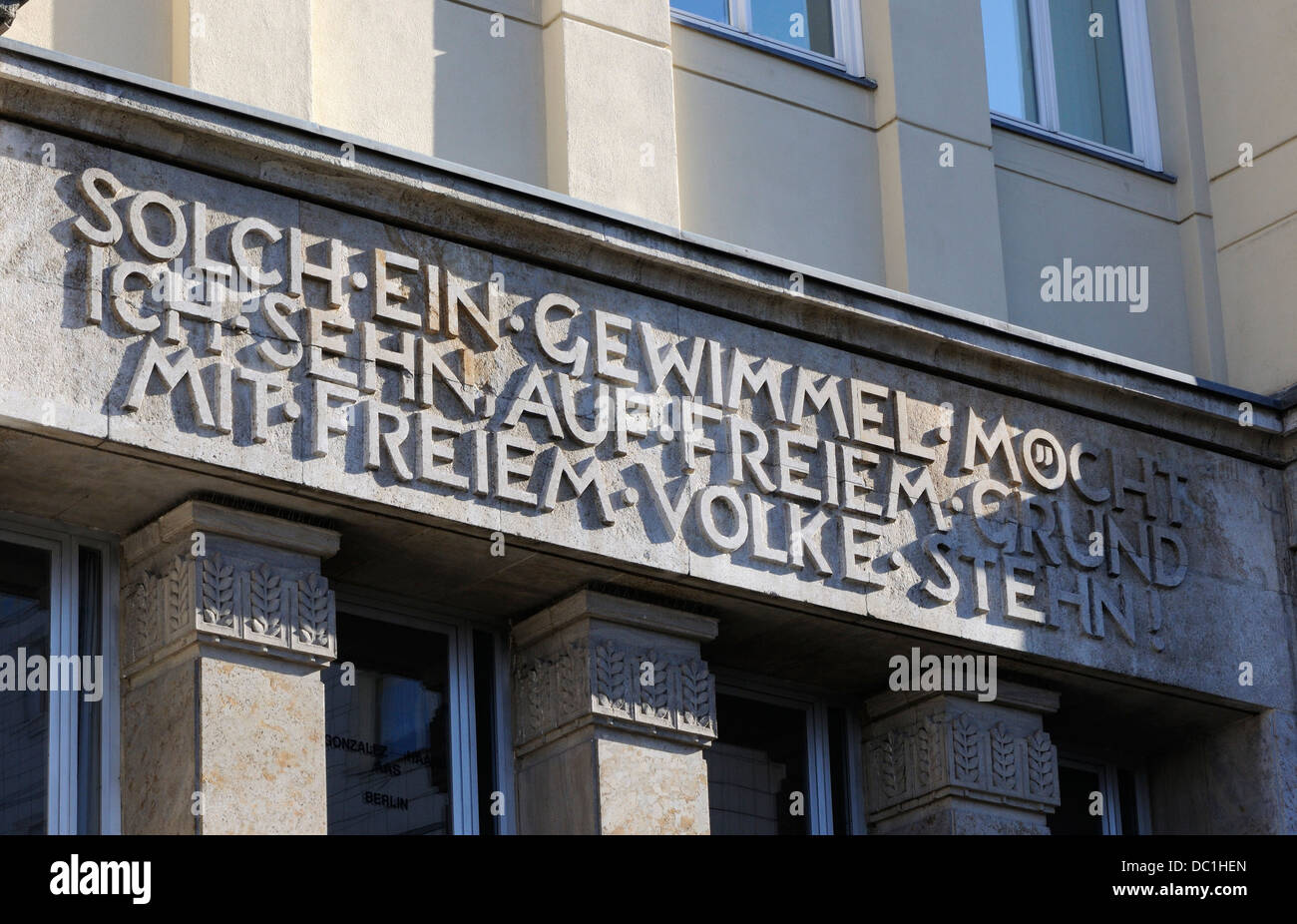 Quote from Goethe's Faust II on a former GDR building on on Strausberger Platz, Berlin, Germany. - Stock Image