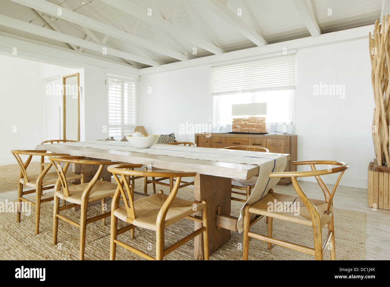 Wooden table in dining room - Stock Image