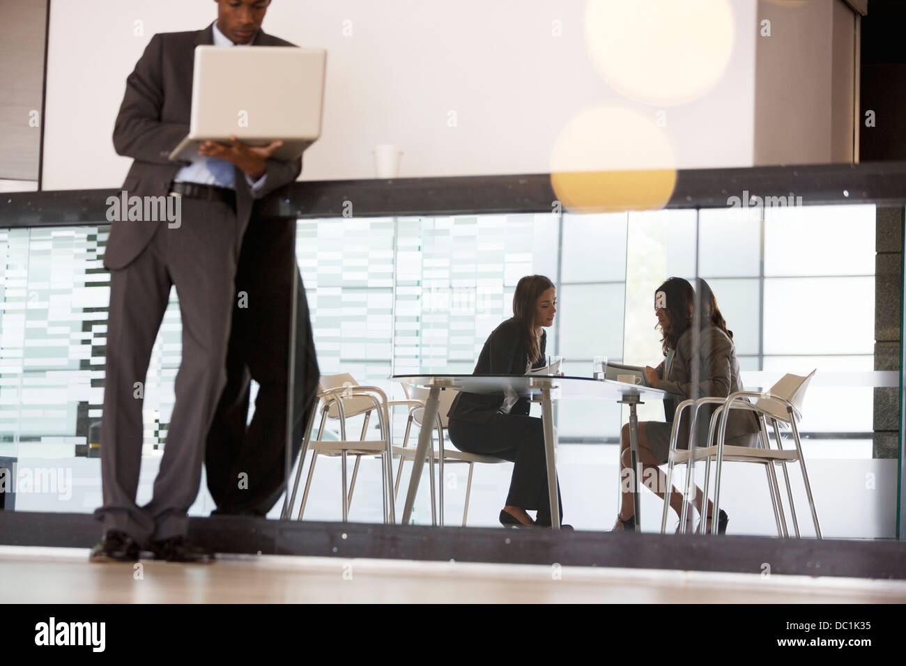 Business people working in lobby Stock Photo