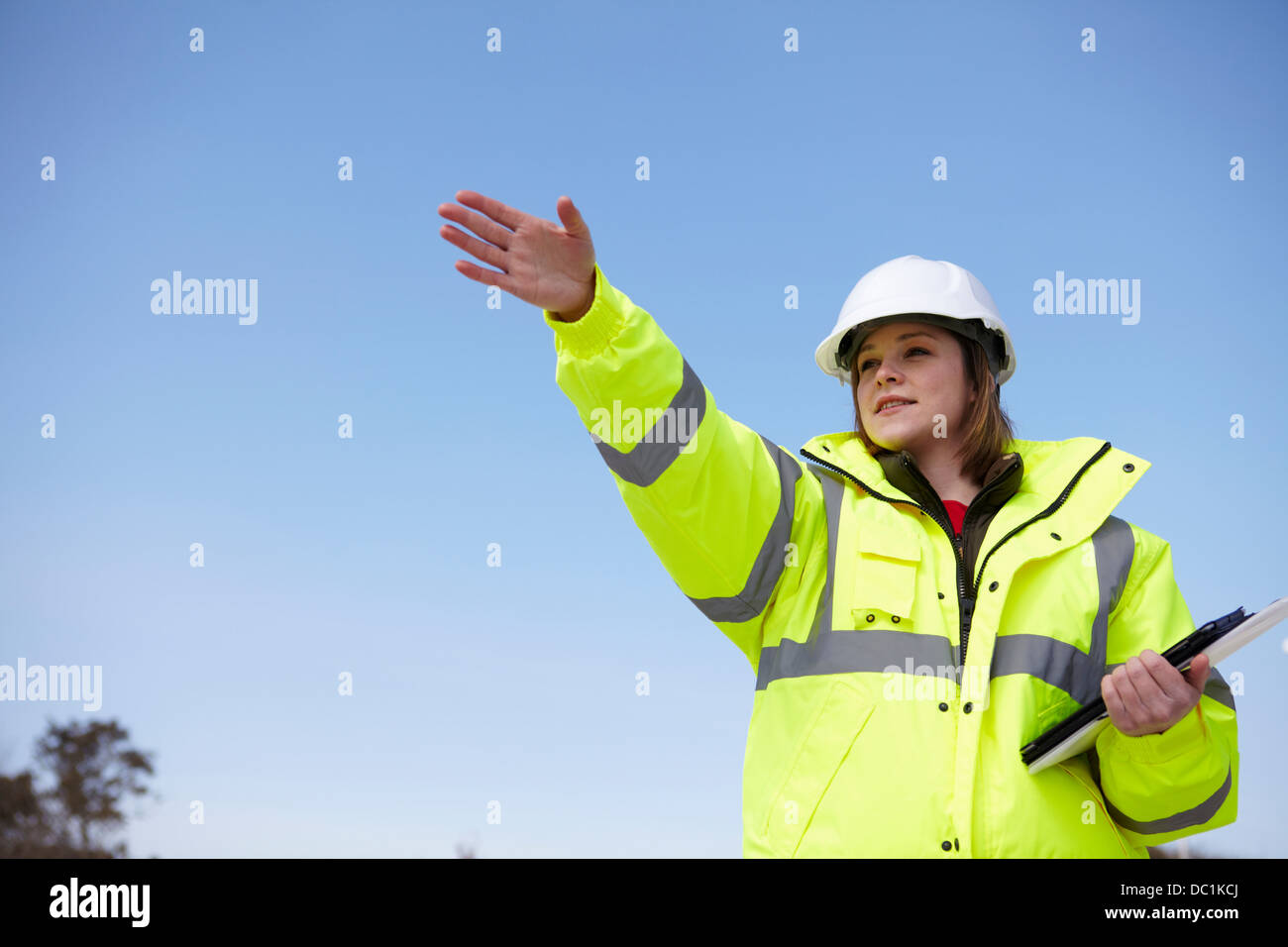 Female project manager with file and digital tablet - Stock Image
