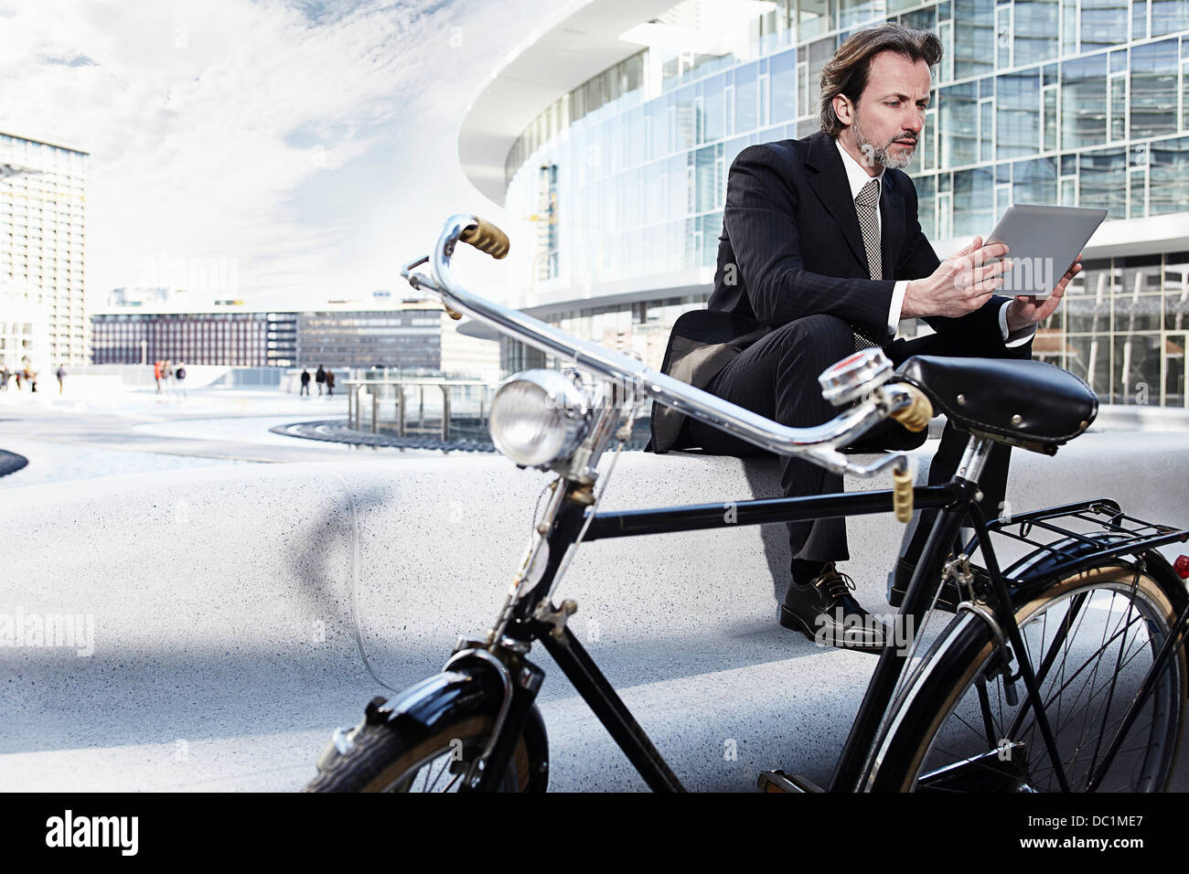 Mid adult businessman using digital tablet in city Stock Photo
