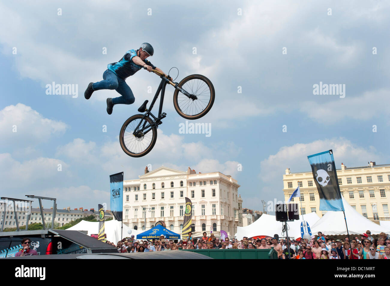 BMX sporting action at a beach festival in Brighton England. - Stock Image