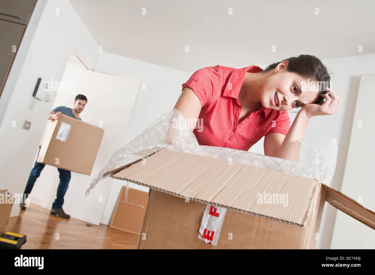 Young couple moving into new home - Stock Image