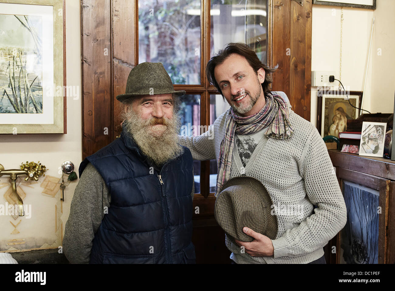 Senior and mid adult man in antique shop, portrait - Stock Image