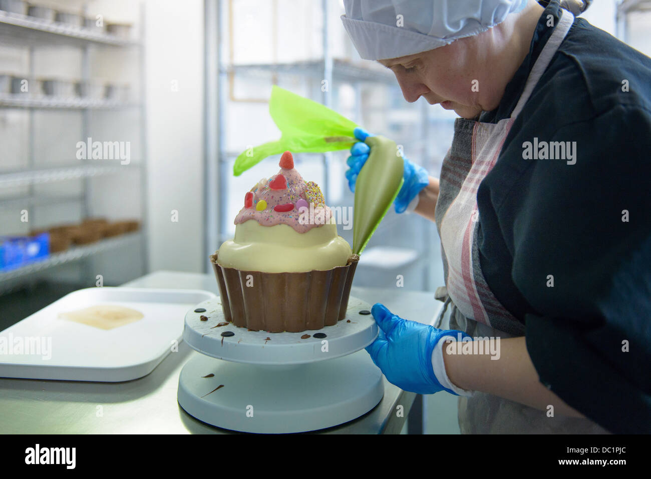 Chocolatier icing giant size cup cake - Stock Image