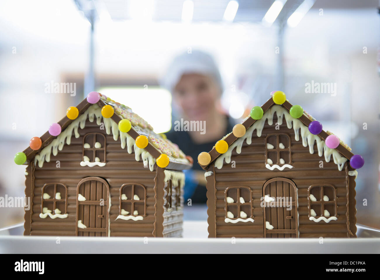 Close up of chocolate houses made in sweet factory - Stock Image