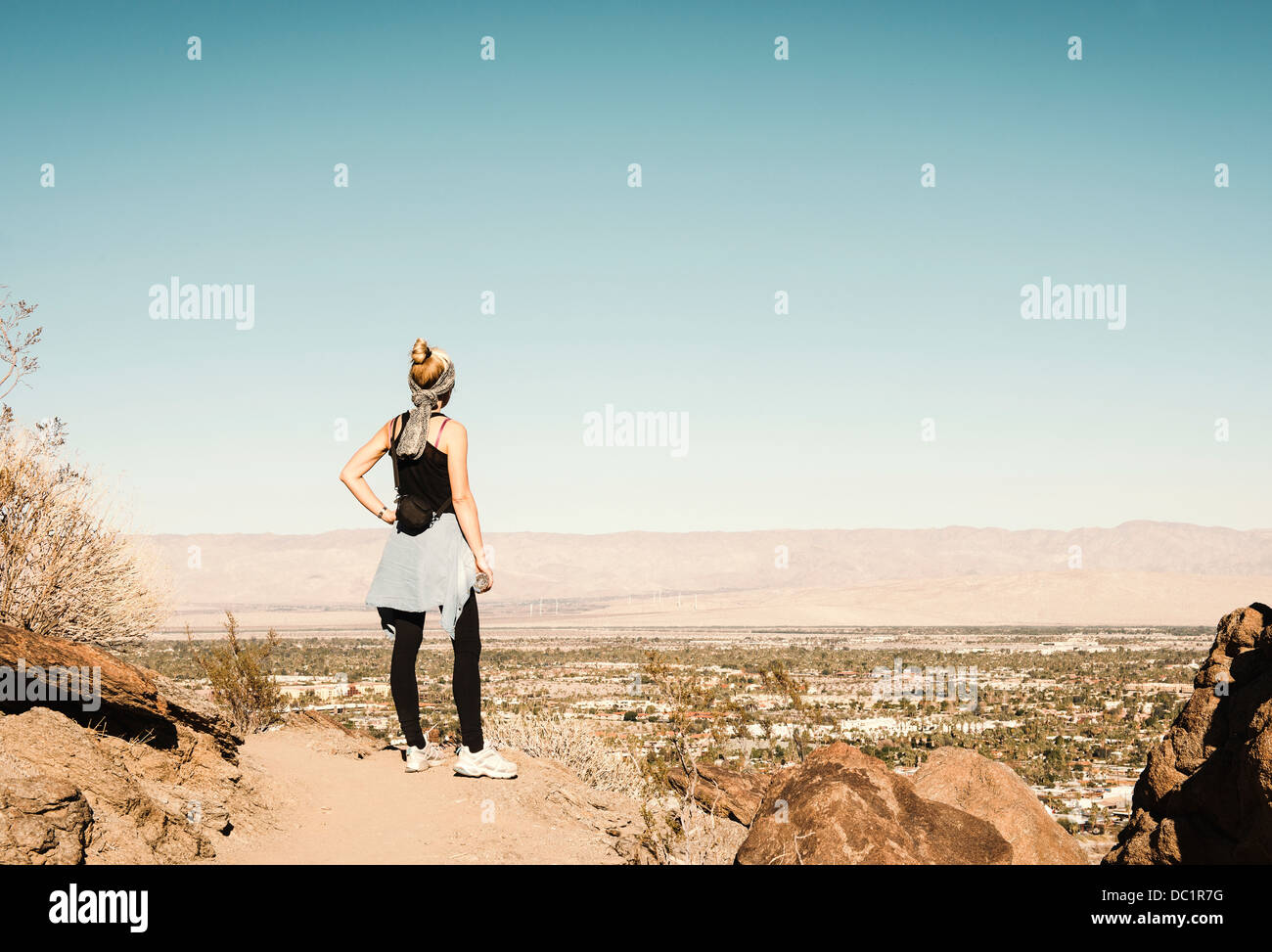 Mid adult hiker looking at view in Palm Springs, California, USA - Stock Image