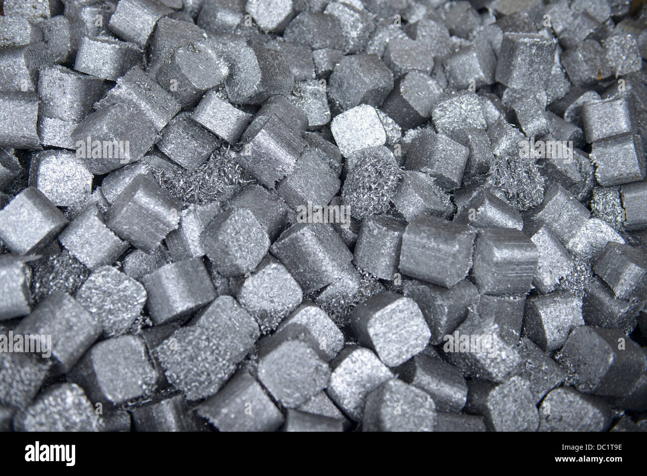 Random stack of cube shaped aluminum products - Stock Image
