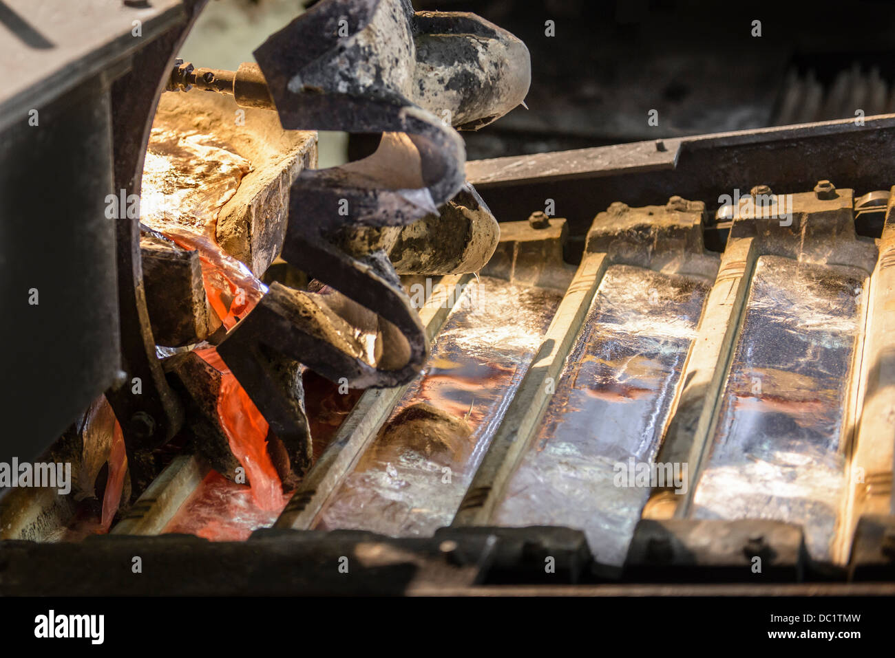 Close up of newly poured metal ingots at aluminum recycling plant - Stock Image