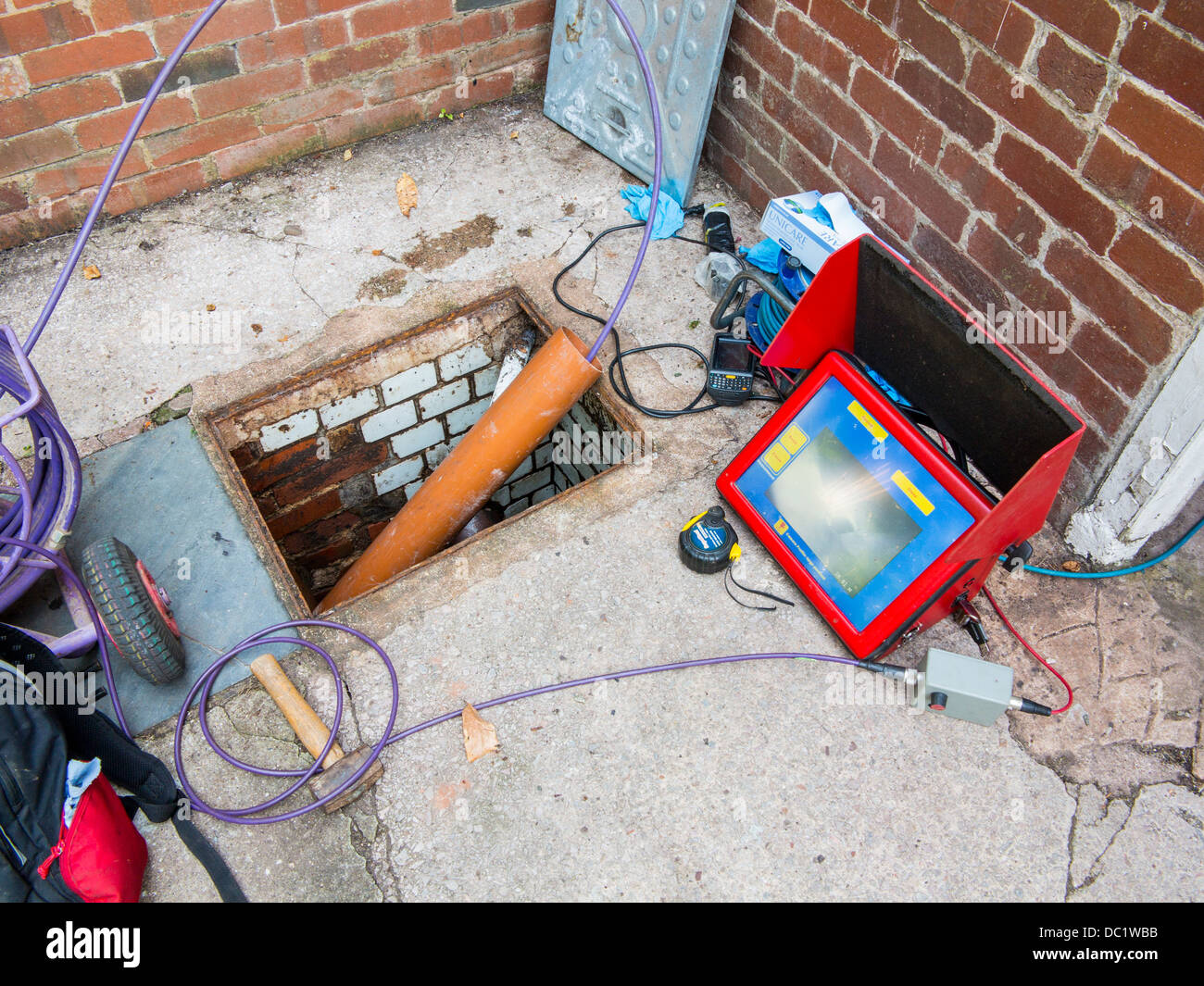 Blocked sewer drain investigation using remote camera - Stock Image