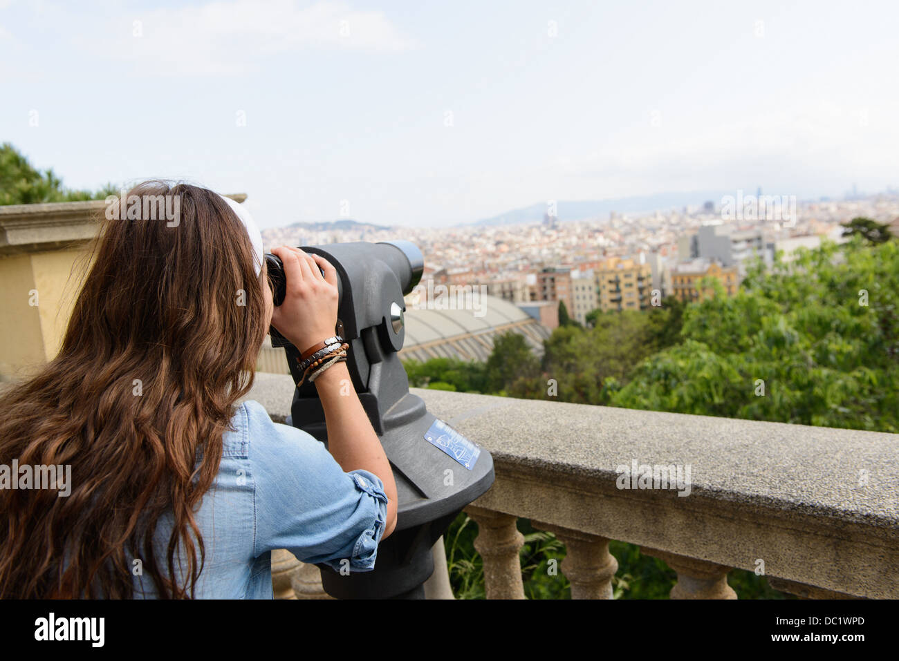 Young female tourist looking at view of Barcelona, Spain - Stock Image