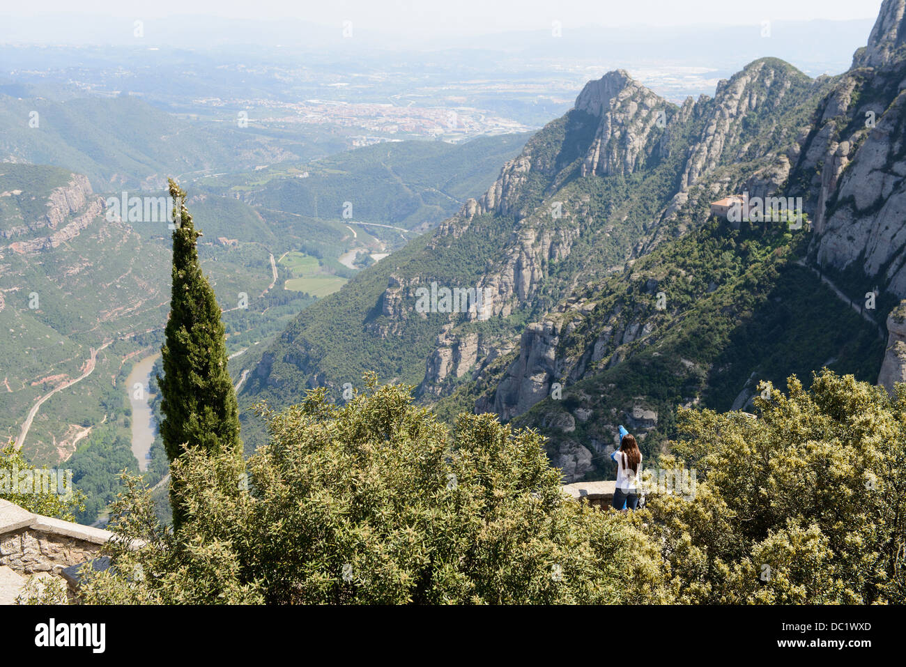 Young female tourist enjoying the view of montserrat, Spain - Stock Image