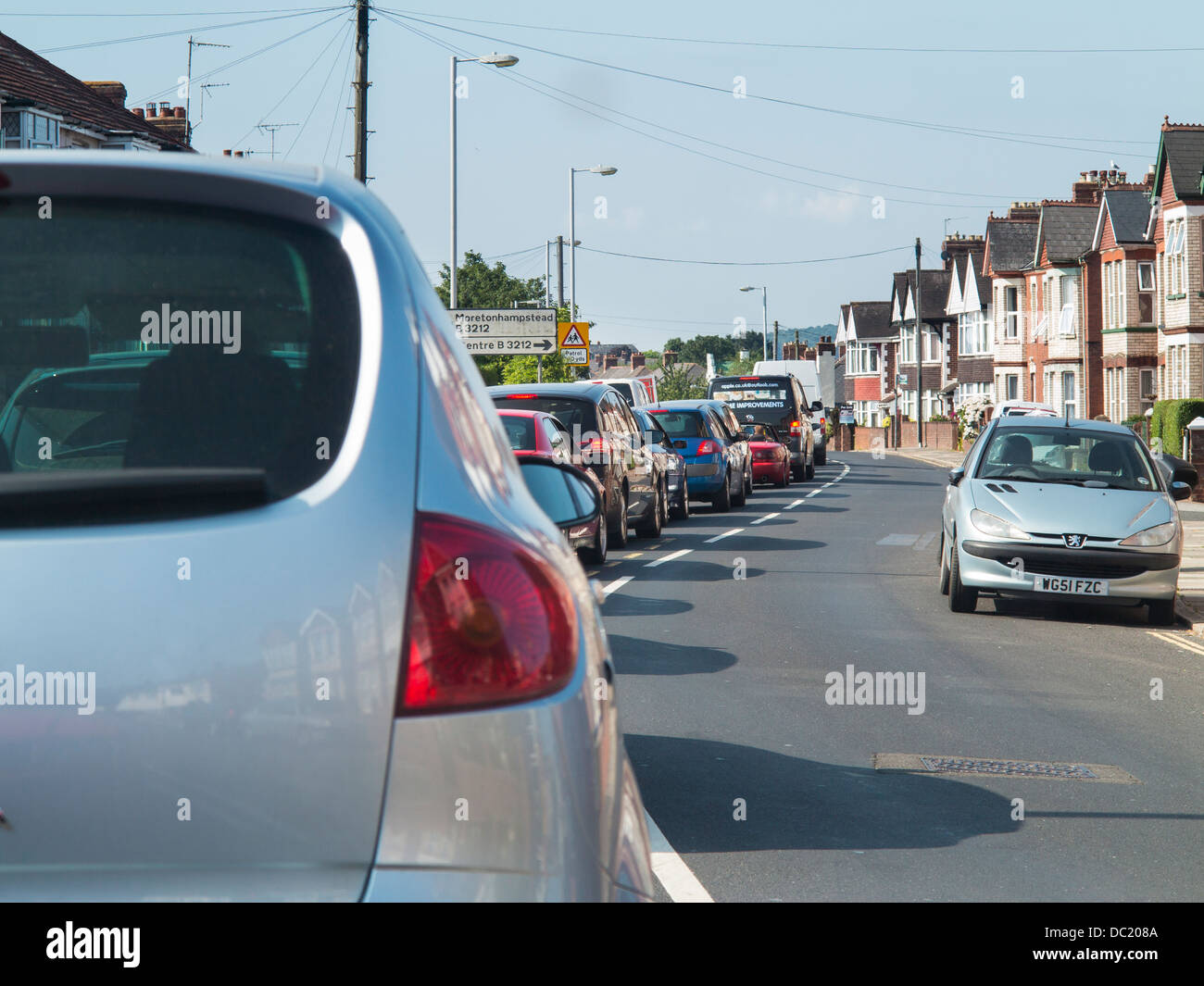 Cars stuck in a traffic queue, Exeter, Devon, England - Stock Image