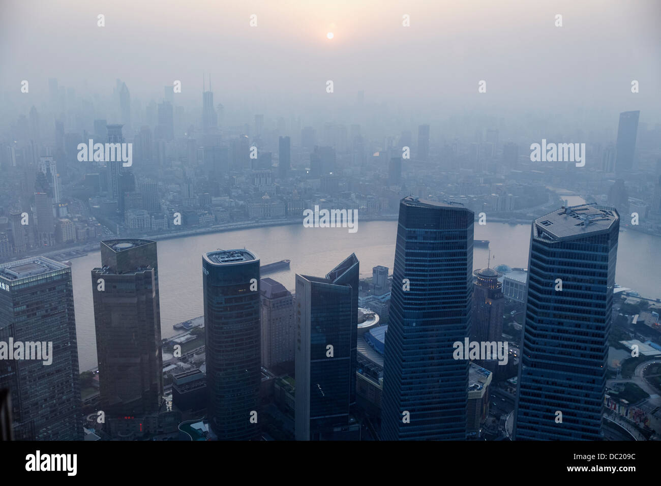 High angle view of misty cityscape, Shanghai, China - Stock Image