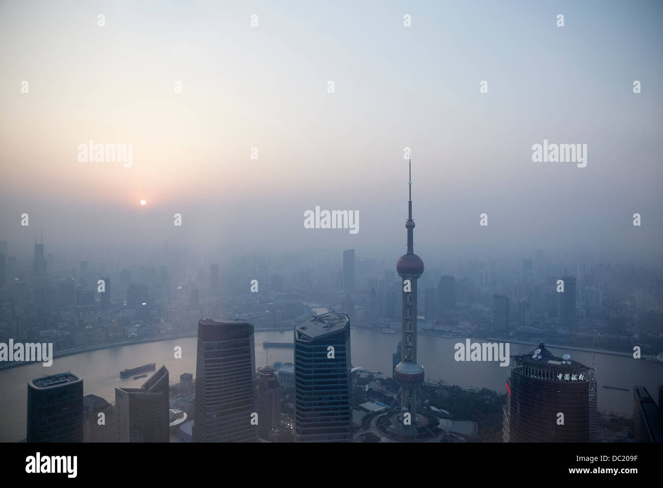 Oriental Pearl Tower and Huangpu River over misty cityscape, Shanghai, China - Stock Image