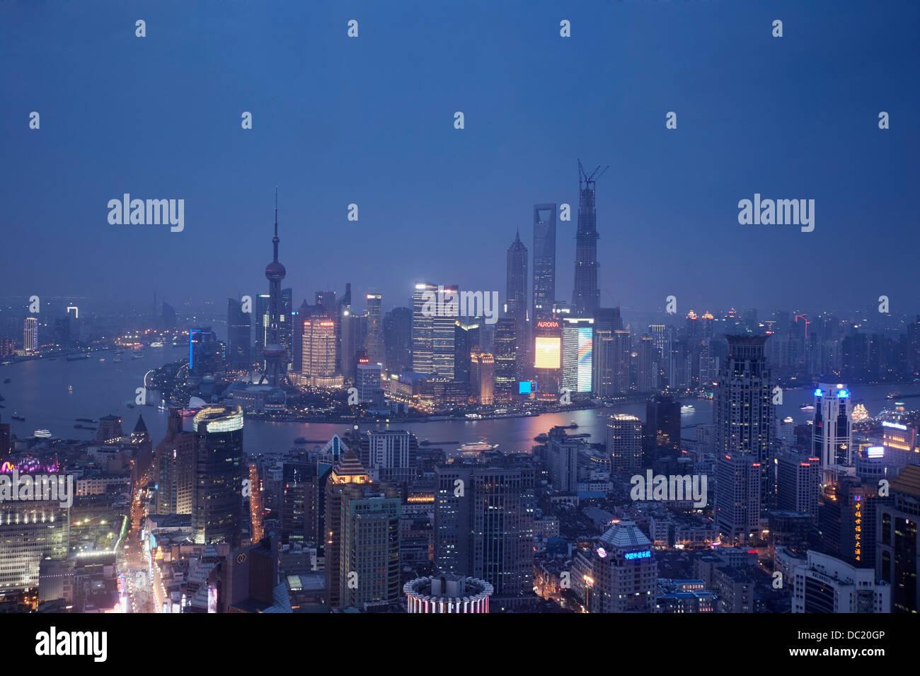 Cityscape of Shanghai at night, China - Stock Image