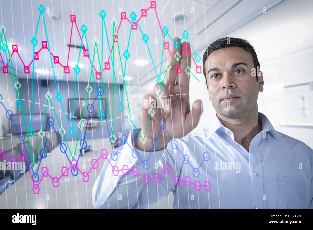 Businessman in office using interactive screen Stock Photo