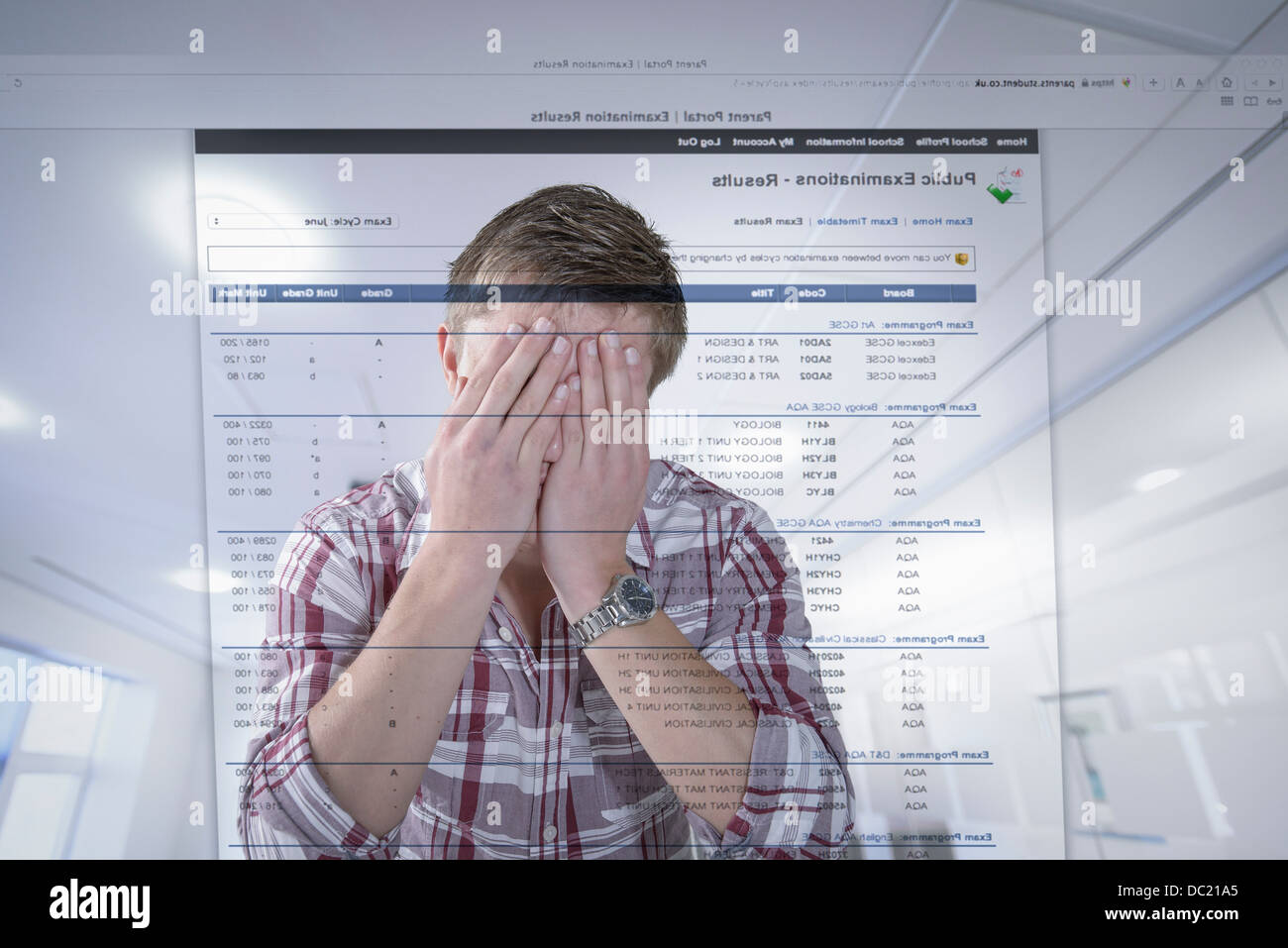 Young student reacting to examination results displayed on screen - Stock Image