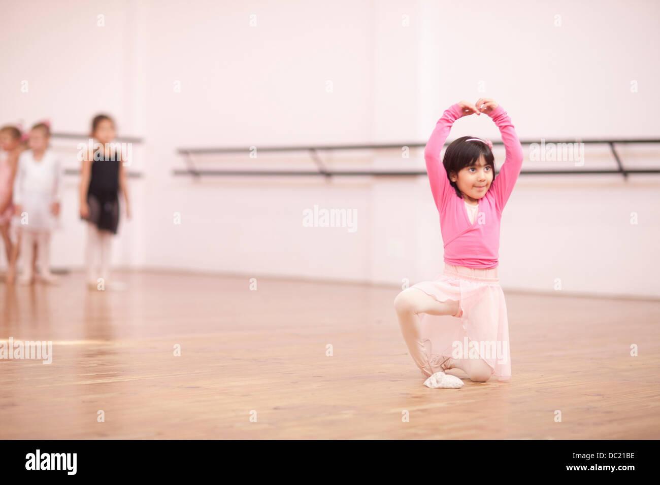 Young ballerina posing in studio Stock Photo