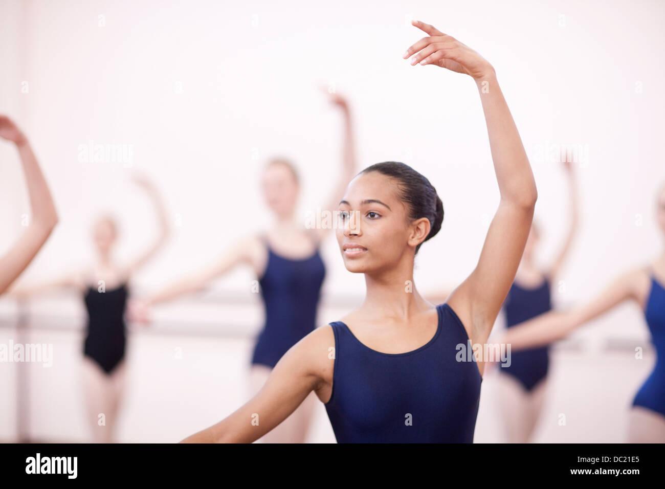 Group of synchronized teenage ballerinas - Stock Image