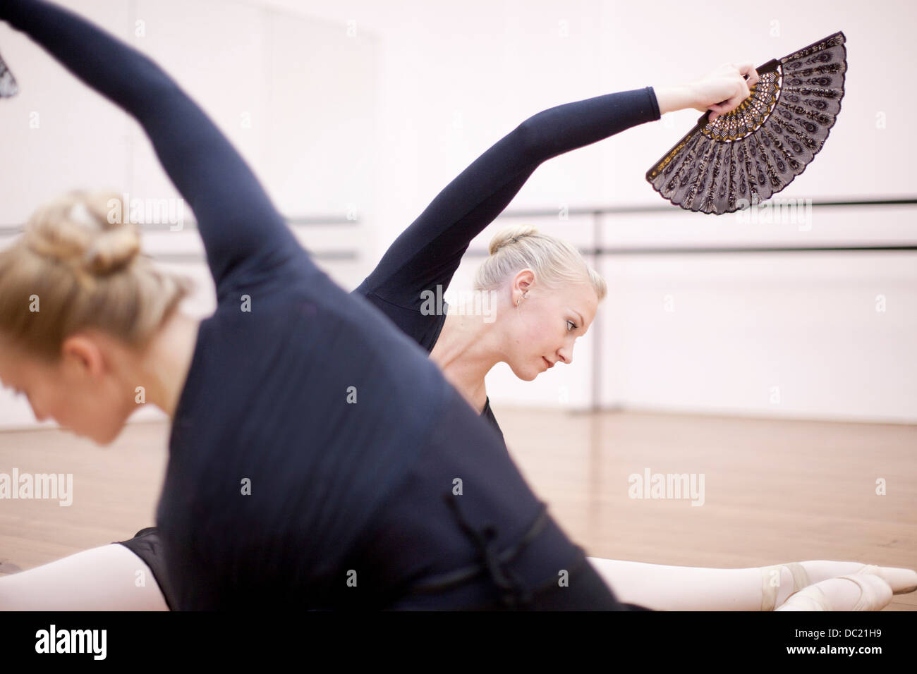 Ballerinas in symmetrical floor pose - Stock Image