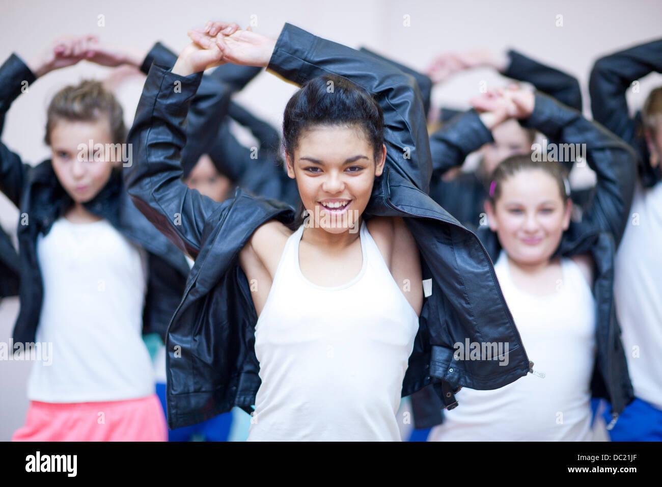 Group of teenagers dancing hip hop in studio - Stock Image