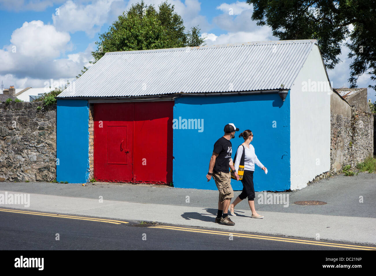 Brightly painted old shed red and blue - outside Dublin, Ireland - Stock Image