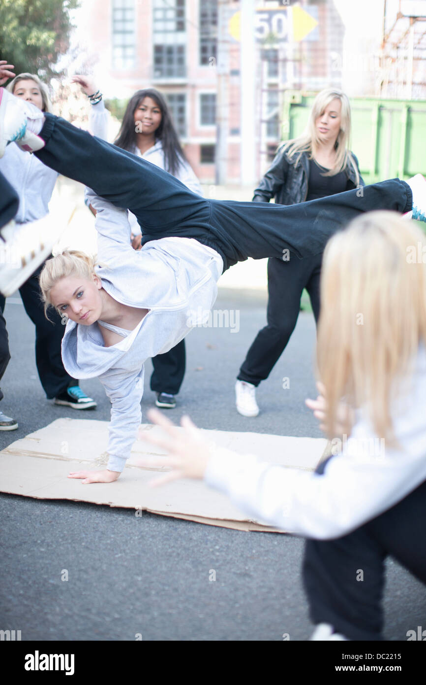 Girl breakdancing in playground Stock Photo