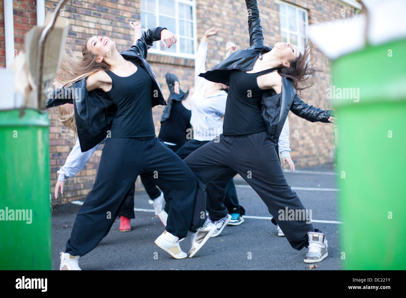Group of girls dancing in carpark Stock Photo