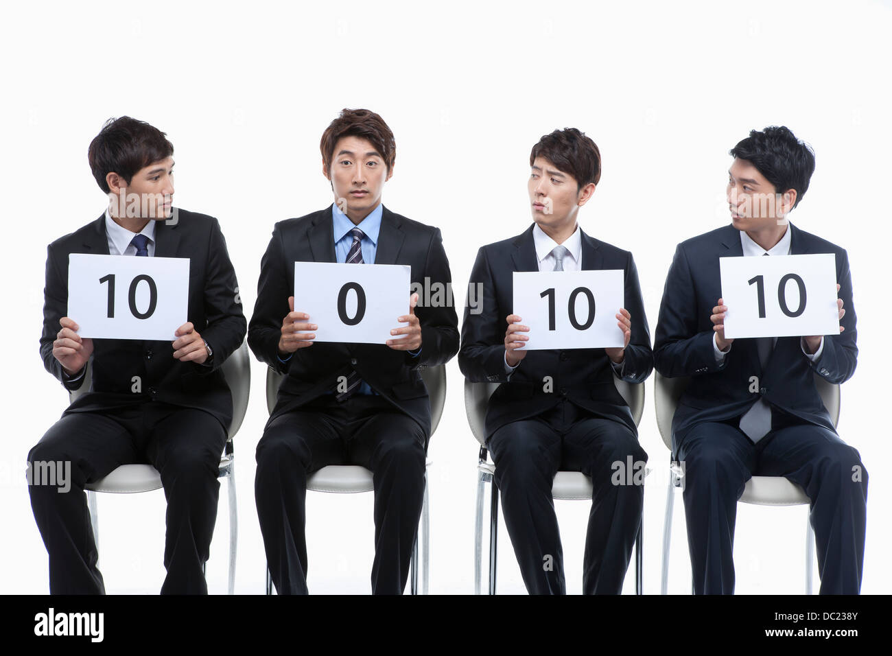 a businessman with zero score among others with 10 score - Stock Image