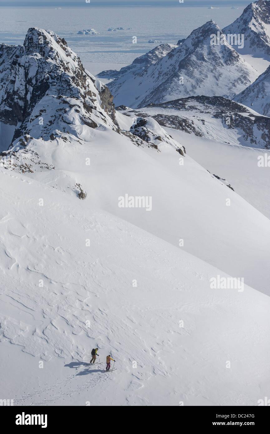 Men skiing in East Greenland - Stock Image
