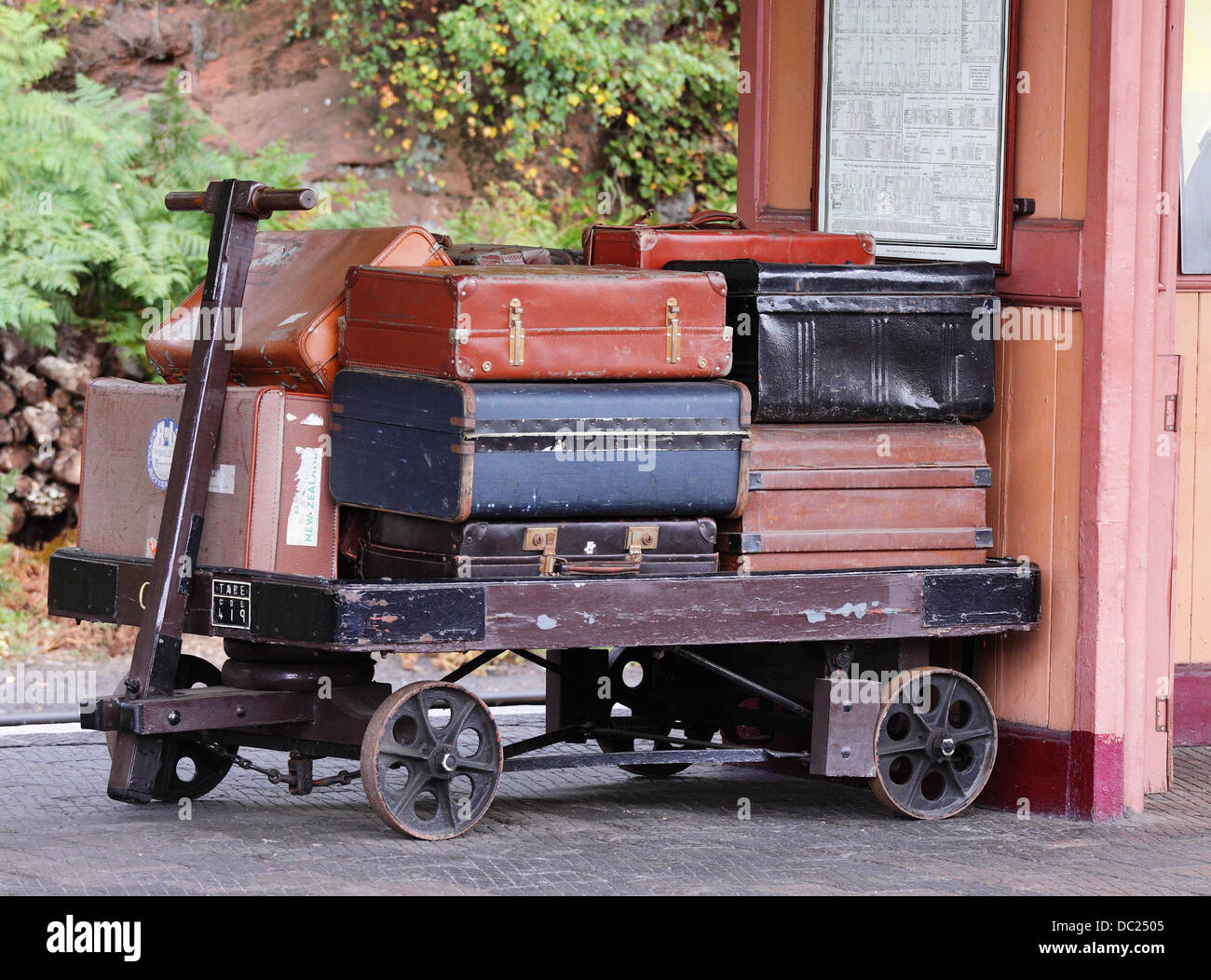 Trolley loaded with vintage baggage on a Station platform - Stock Image
