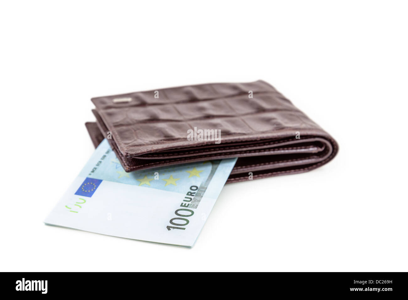 The brown leather wallet with euro is photographed on the close-up - Stock Image