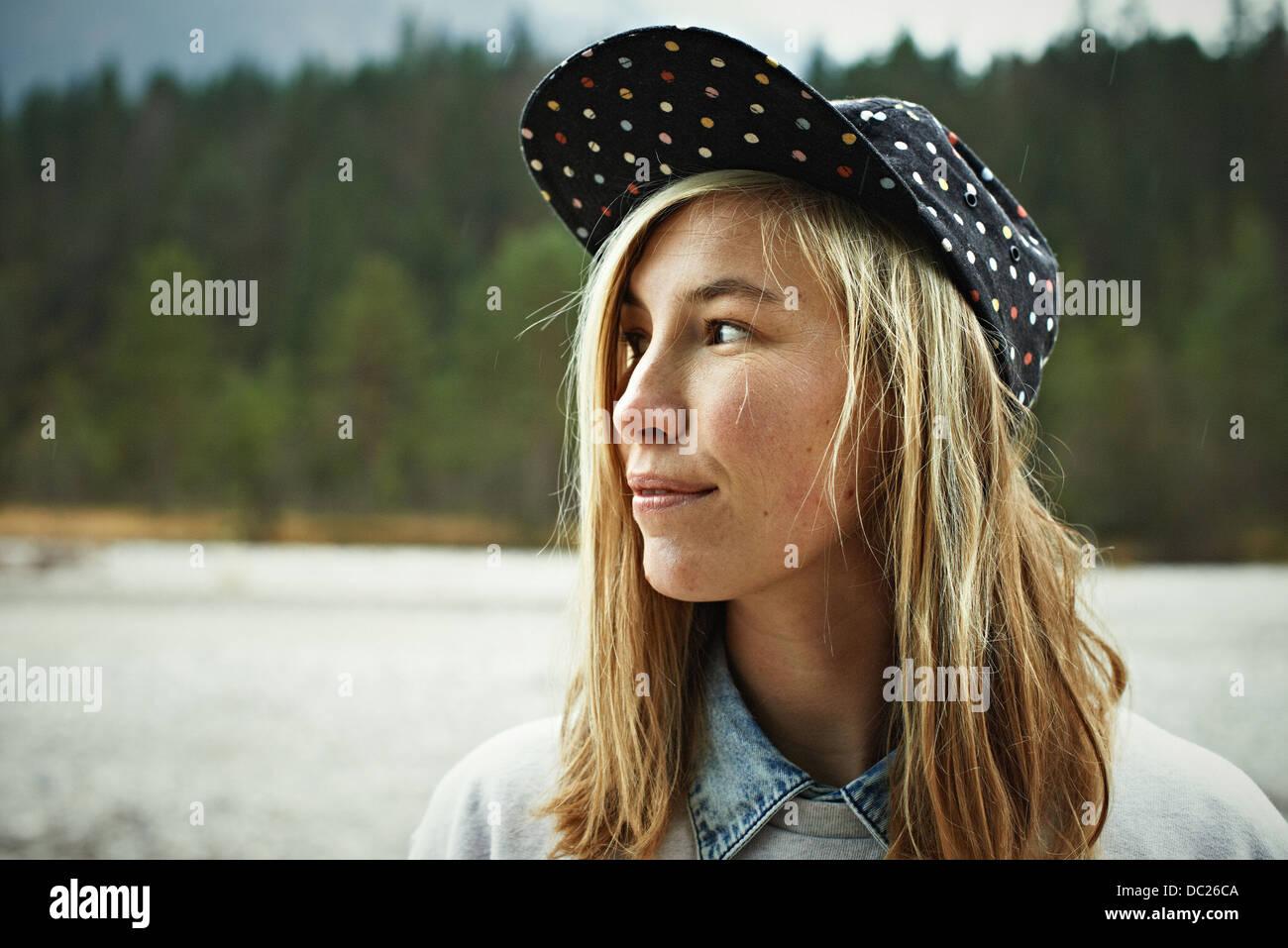 Portrait of woman wearing cap headwear - Stock Image