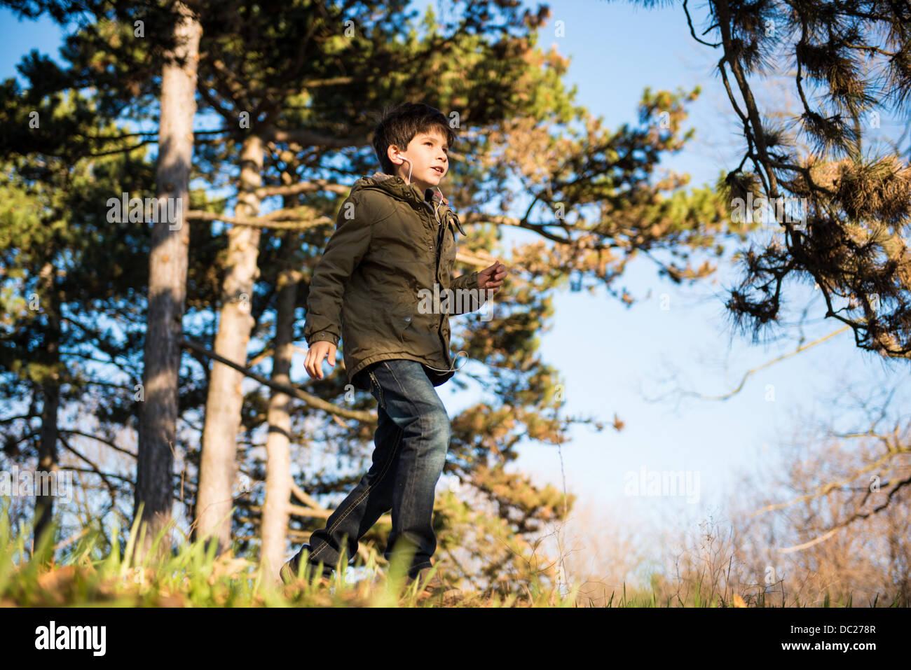 Boy walking in countryside - Stock Image