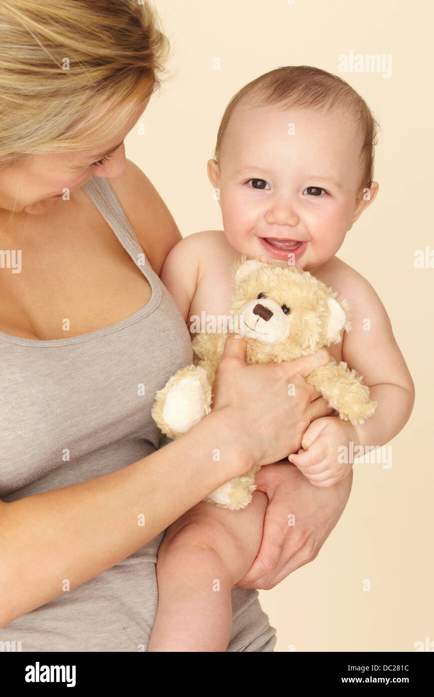 Mother with baby son and teddy bear - Stock Image