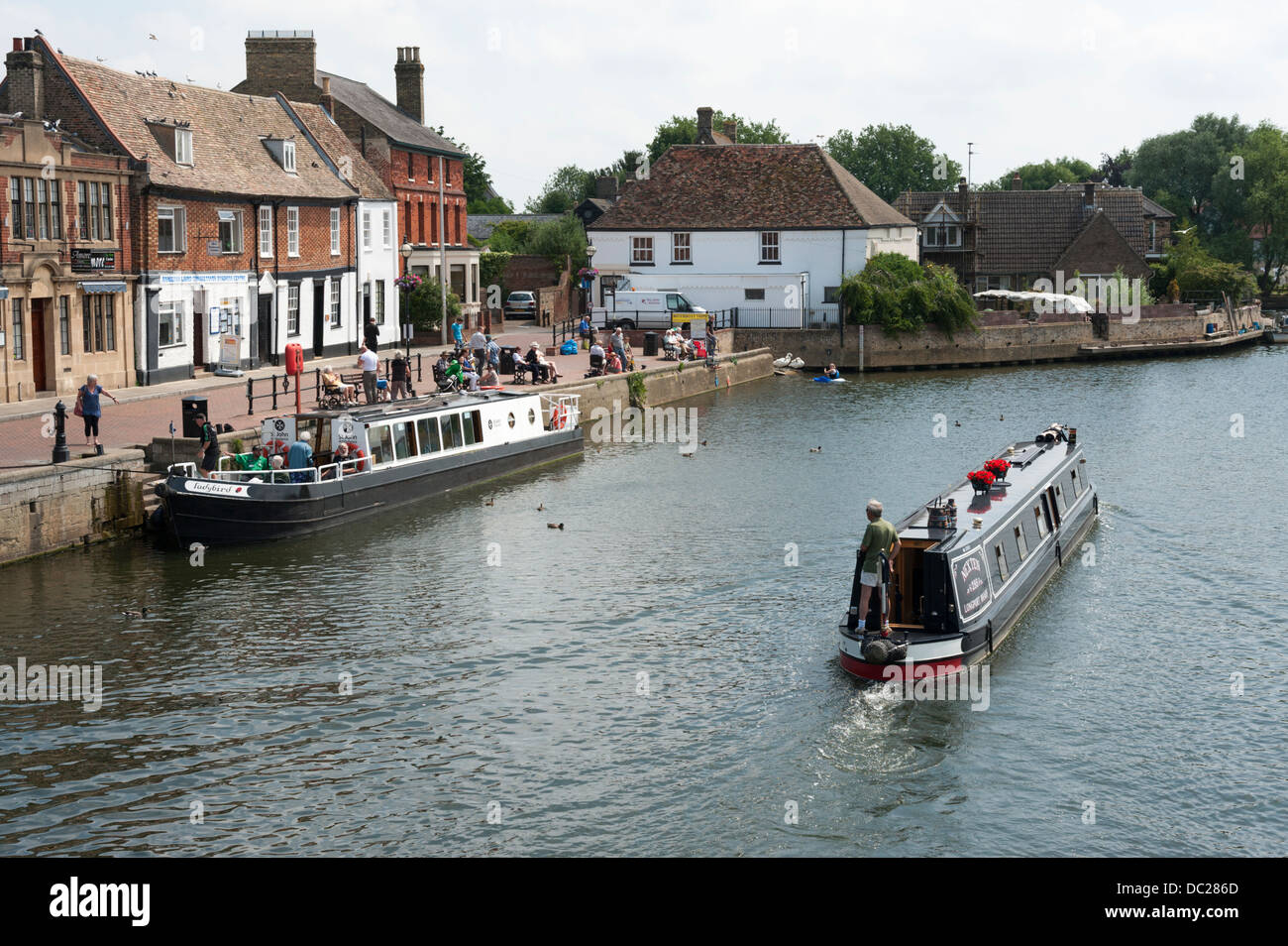 A narrowboat or longboat on the River Great Ouse St Ives Cambridgeshire UK on a sunny summer day - Stock Image