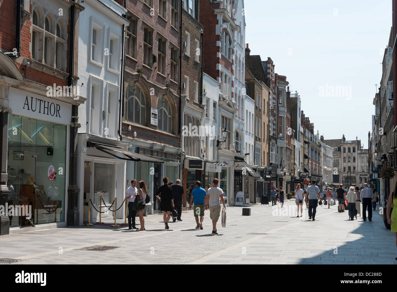 Shops and shoppers in South Molton Street London UK on a sunny summer day - Stock Image