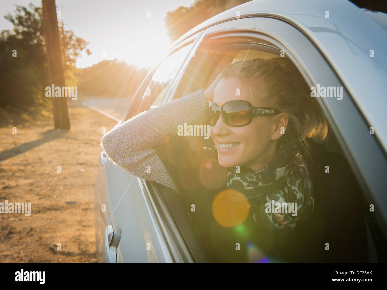 Woman looking out of car window - Stock Image