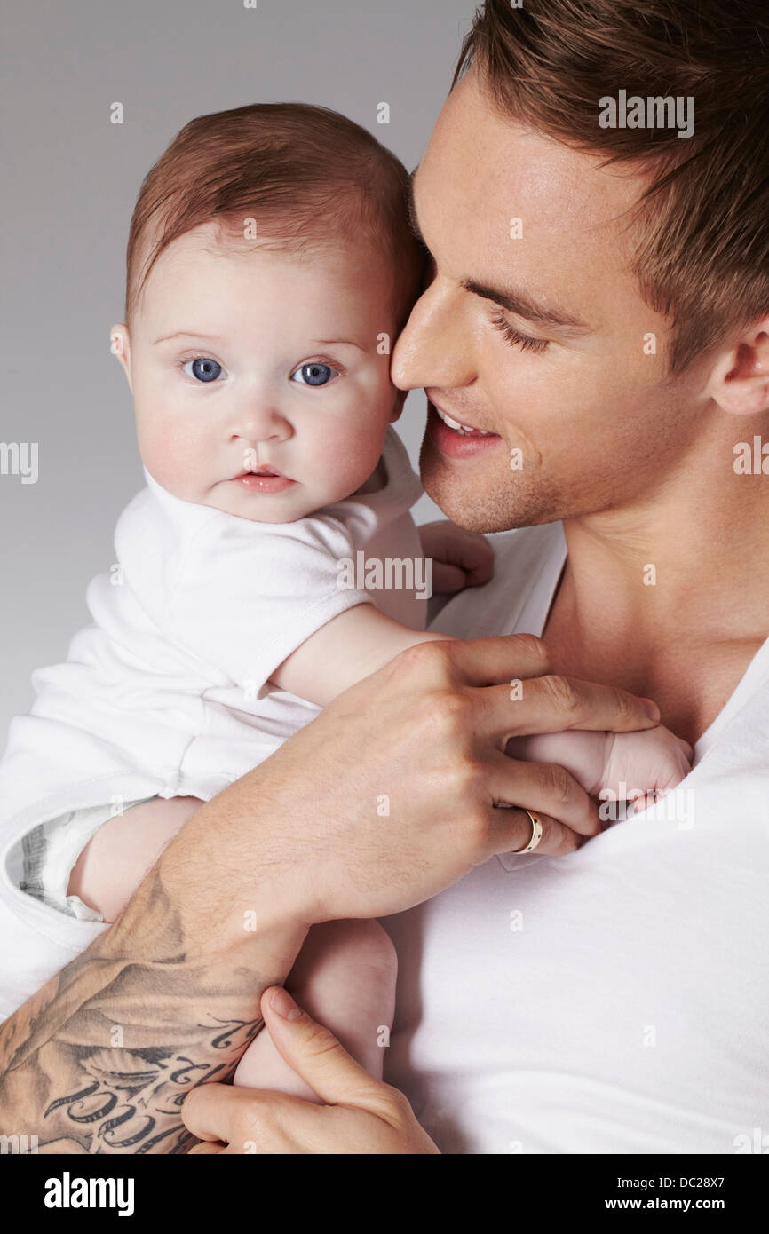 Father with baby daughter - Stock Image