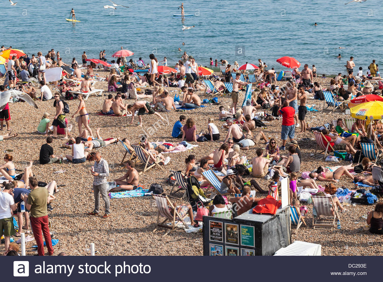 Busy beach, Brighton, England, UK - Stock Image