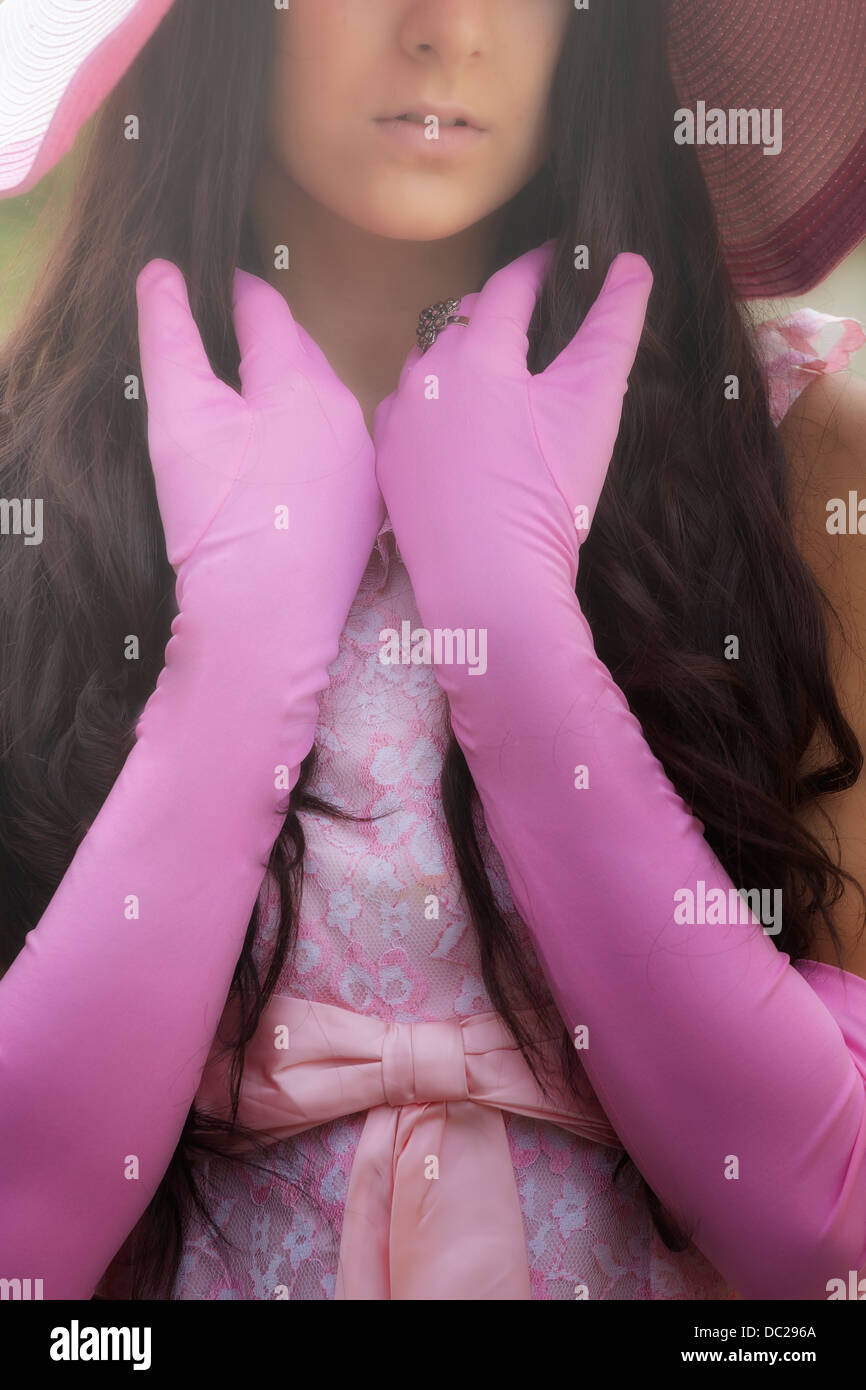 detail view of a girl with pink gloves - Stock Image