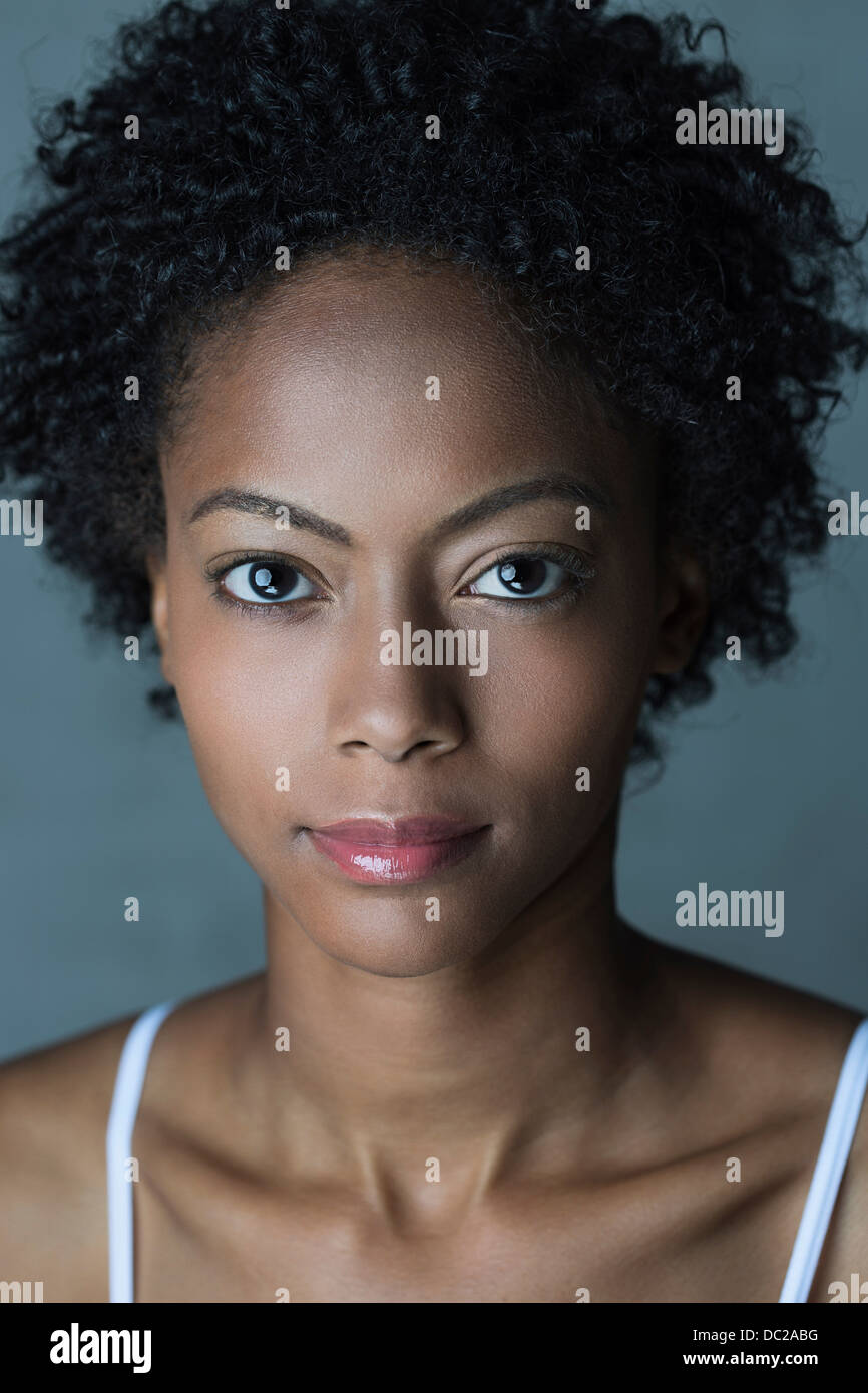 Portrait of woman with afro hair - Stock Image