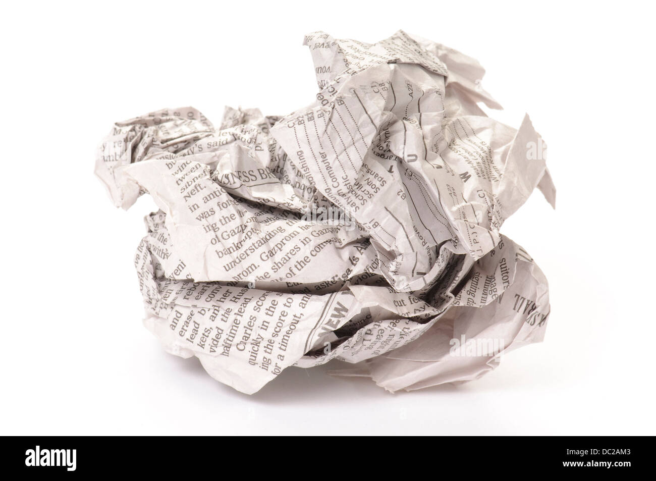 Studio portrait of crumpled up newspaper on white background. - Stock Image