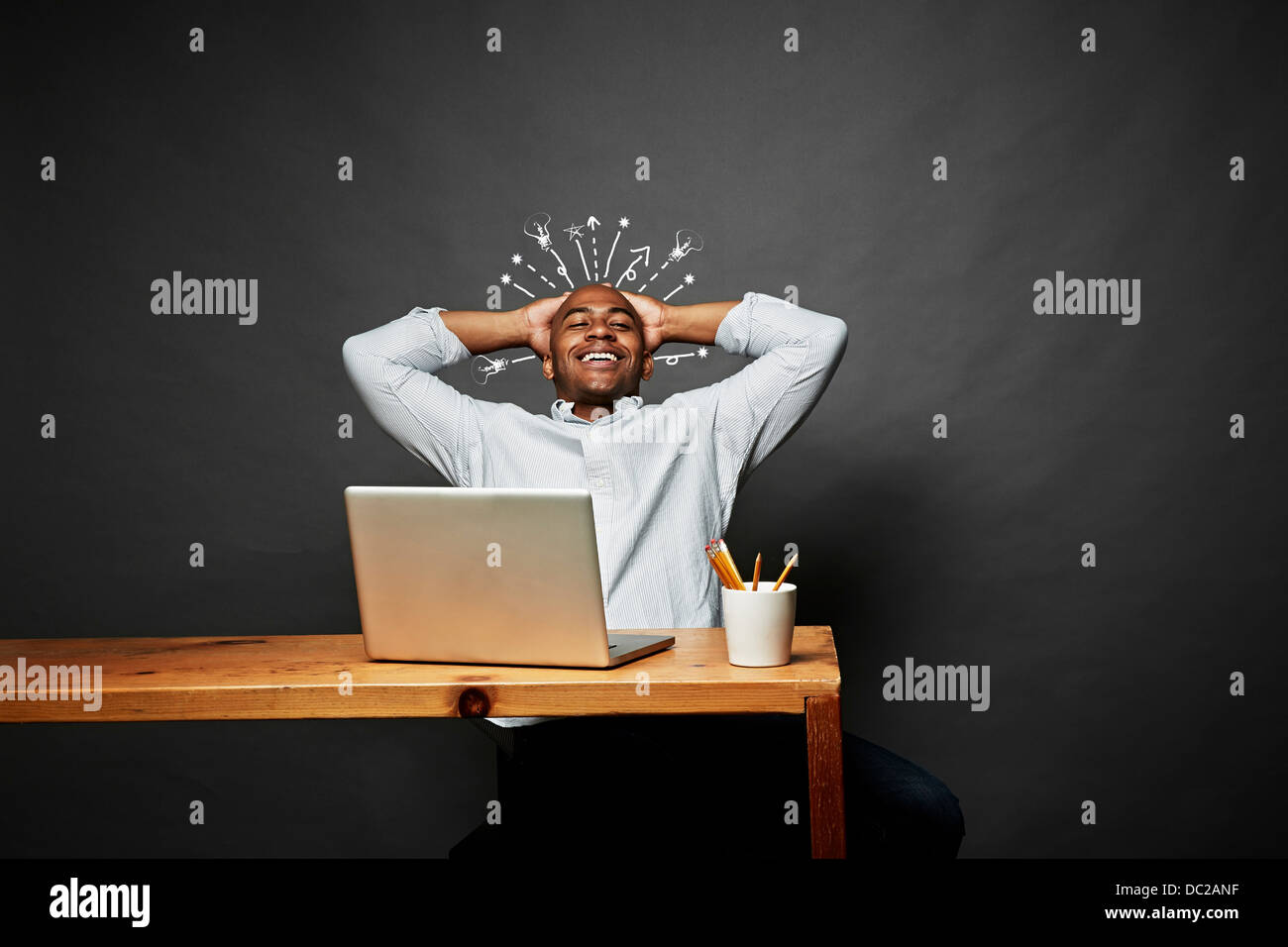 Man laughing with explosion of ideas - Stock Image
