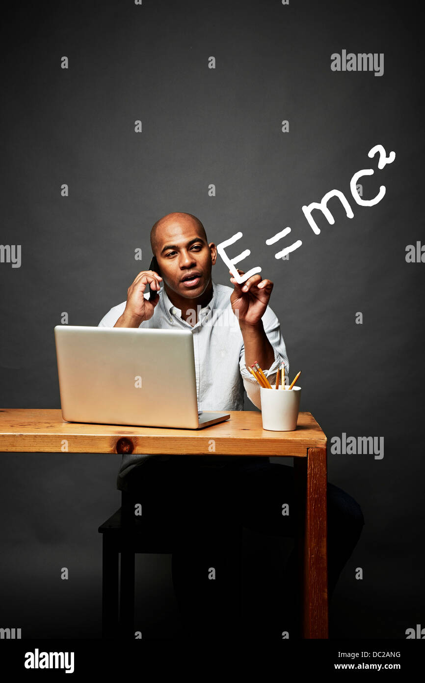 Man on mobile phone explaining mathematical equation - Stock Image
