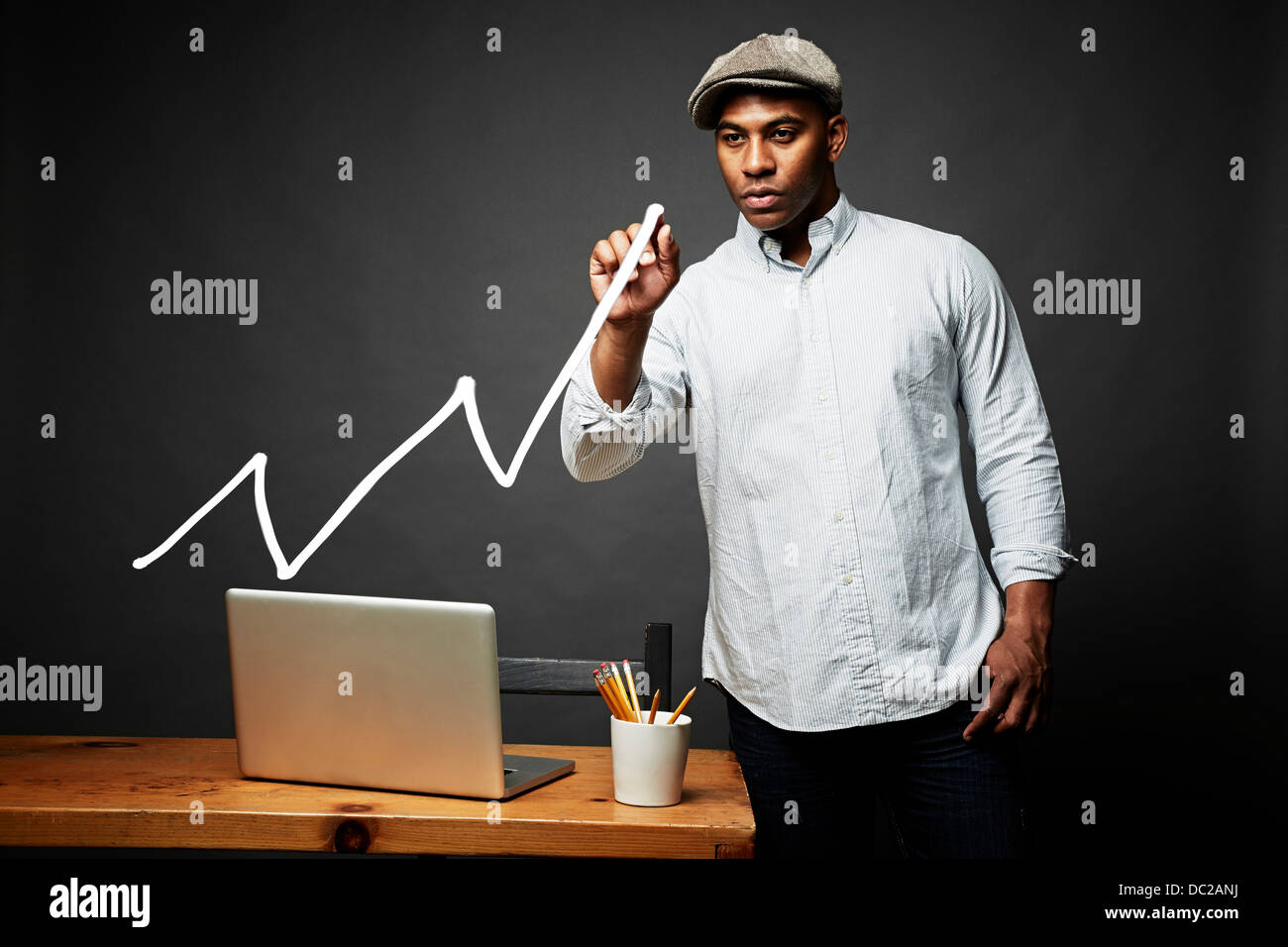 Man drawing line graph - Stock Image