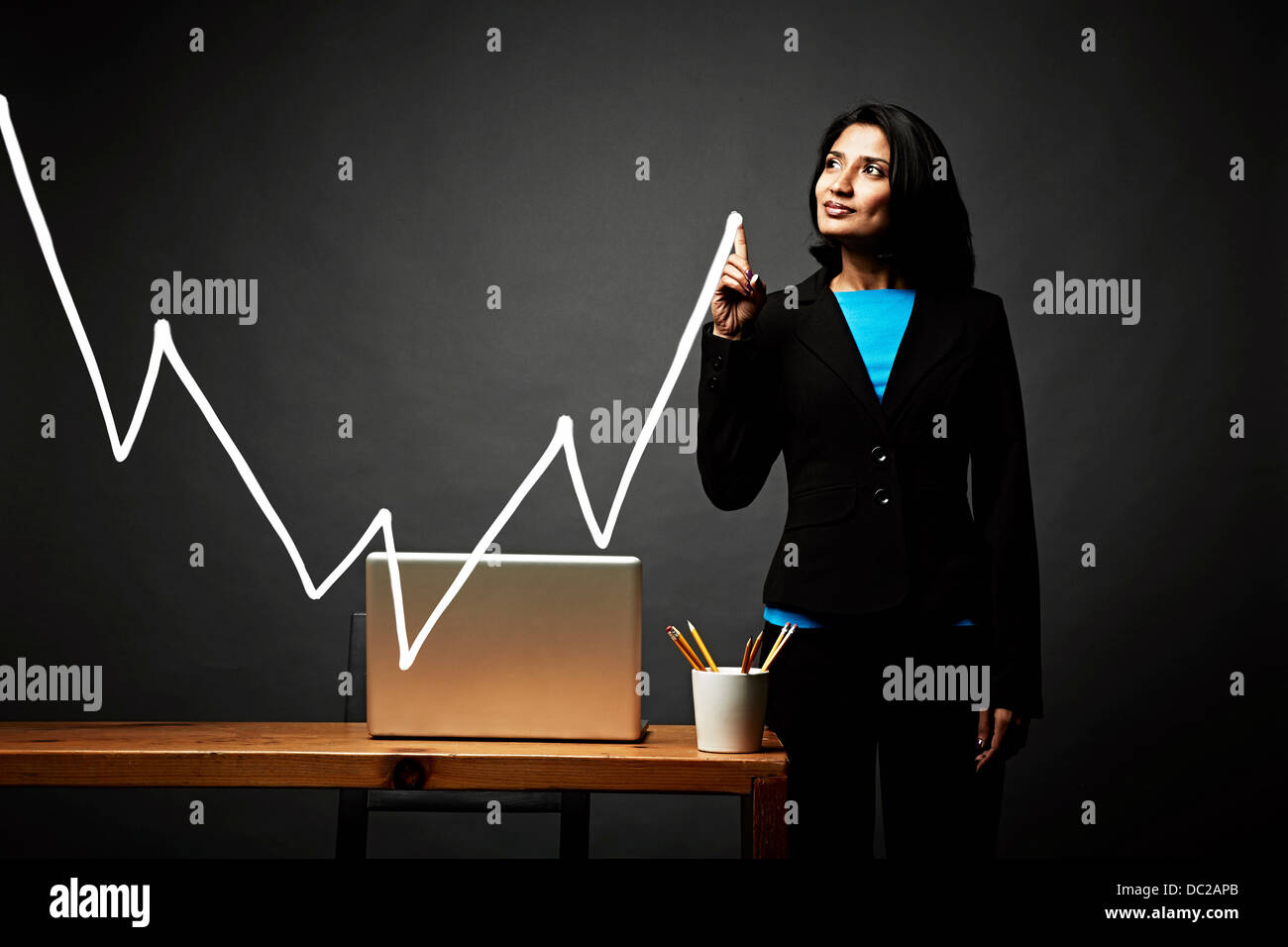 Woman drawing line graph - Stock Image