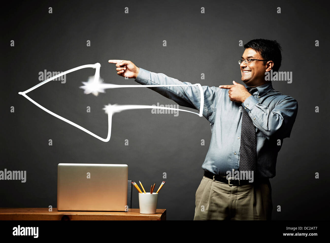 Man pointing the way with a big smile - Stock Image